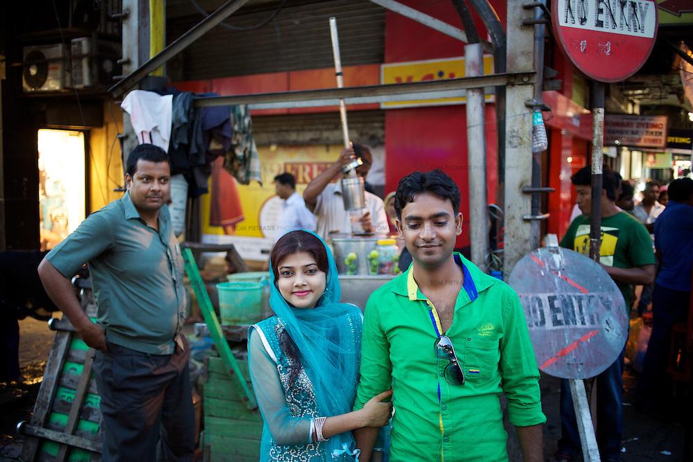 A couple at a Kolkata market.<br /> <br /> Photo: Tom Pietrasik<br /> April 14th 2014<br /> Kolkata, India