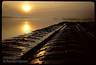 Sunrise on Mississippi River with barges in foreground; October, near Hannibal. Missouri
