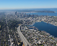 Aerial view taken from over I-5, looking SSW to downtown Seattle. The neighborhoods visible in the foreground are (from left to right): Capitol Hill, Eastlake, South Lake Union, Westlake, and Lower Queen Anne.
