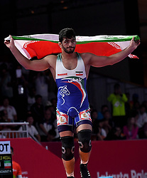 JAKARTA, Aug. 19, 2018  Hassan Yazdanicharati of Iran celebrates after Men's Wrestling Freestyle 86 kg Final against Domenic Michael Abounader of Lebanon at the 18th Asian Games at Jakarta, Indonesia, Aug. 19, 2018. (Credit Image: © Yue Yuewei/Xinhua via ZUMA Wire)