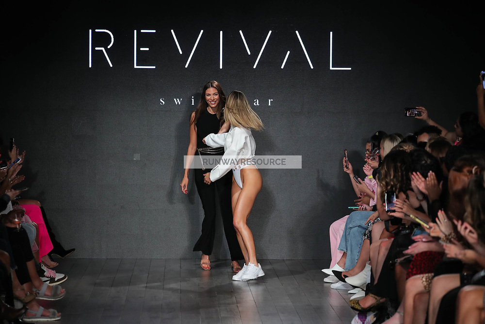 Designer Marion Sealy and a model walk the runway during Revival Swimwear Runway Show Hosted by Klarna STYLE360 NYFW on September 11, 2019 in New York City
