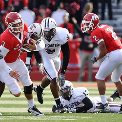 Oct 10, 2009; Piscataway, NJ, USA; Rutgers quarterback Tom Savage (7) is wrapped up at the end of a first down run during first half NCAA college football action between Rutgers and Texas Southern at Rutgers Stadium.