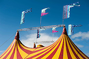 Stripey big tops are all over the site. The 2013 Glastonbury Festival, Worthy Farm, Glastonbury. 30 June 2013. © Guy Bell, guy@gbphotos.com, all rights reserved