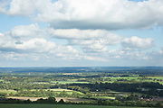 View over the beautiful English countryside at Steyning, in West Sussex, England, UK. Light clouds in the sky over typically British country.