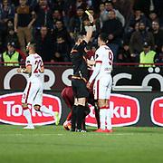 Referee's Ali Palabiyik show the yellow card to Galatasaray's Umut Bulut during their Turkish SuperLeague Derby match Trabzonspor between Galatasaray at the Avni Aker Stadium at Trabzon Turkey on Sunday, 19 April 2015. Photo by TVPN/TURKPIX