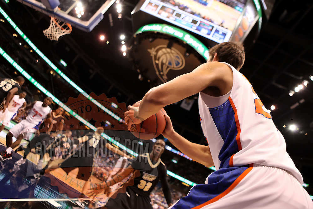 Florida Gators forward Chandler Parsons (25) in-bounds the ball against the University of Central Florida Knights  at the Amway Center on December 1, 2010 in Orlando, Florida. Central Florida won the game 57-54 for their first ever victory against a nationally ranked team. (AP Photo/Alex Menendez)