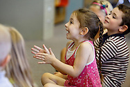 """Elaina McQuiston claps as her teacher Susan Bennett reads """"Pete the Cat: I Love My White Shoes"""" during kindergarten orientation at Walden Elementary School on Tuesday, Aug. 27, 2013."""