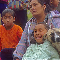 A family watches in curiosity as the first-ever tourists visit their village of Yamblon in Peru's Cordillera Central.