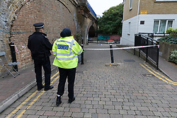© Licensed to London News Pictures. 22/09/2018. London, UK.  Police officers at the scene in Island Row in Limehouse, Tower Hamlets, E14 where police were called after a 17 year old boy was stabbed last night at around 8:30pm..  Photo credit: Vickie Flores/LNP