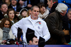 England head coach Stuart Lancaster takes hi seat before the first half of the match - Photo mandatory by-line: Rogan Thomson/JMP - Tel: Mobile: 07966 386802 02/02/2013 - SPORT - RUGBY UNION - Twickenham Stadium - London. England v Scotland - 2013 RBS Six Nations Championship. The winner of this fixture is awarded the Calcutta Cup.