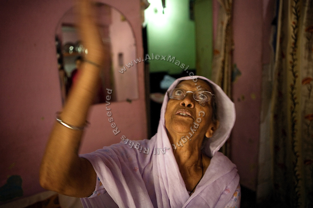 Harbans Kaur, 70, is sitting in her home in Tilak Vihar, New Delhi, India. She has lost her husband, four sons and two son-in-laws during the anti-Sikh riots erupted in New Delhi in 1984 in the light of Indira Gandhi's assassination by her Sikh bodyguards.