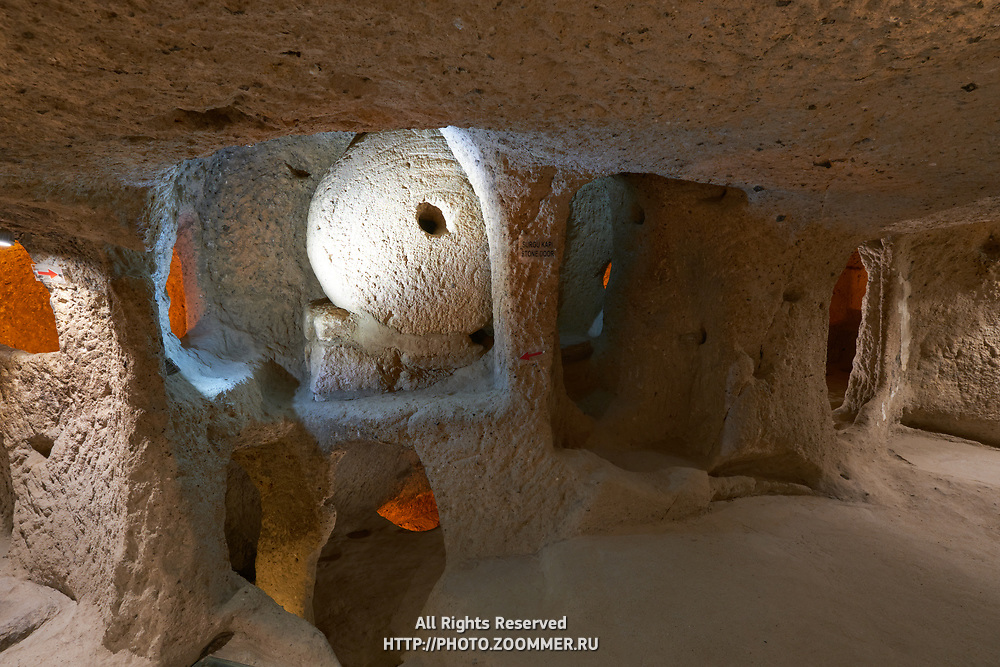 Massive round stone door in Kaymakli underground city, Cappadocia, Turkey