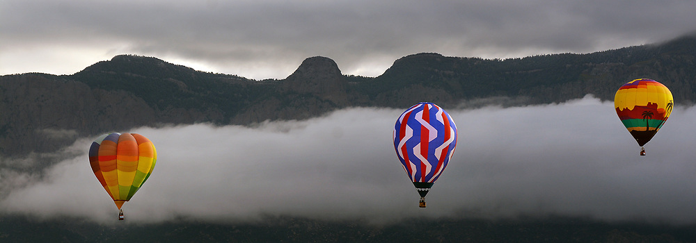 October 9, 2018 - Albuquerque, New Mexico, U.S. - A whip of clouds skirt the Sandia Mountains as balloons take to the skies on the fourth day of the Albuquerque International Balloon Fiesta.  (Credit Image: © Jim Thompson/Albuquerque Journal via ZUMA Wire)