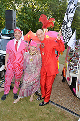 Left to right, PIERS ATKINSON, ZANDRA RHODES and ANDREW LOGAN at the Quintessentially Foundation and Elephant Family 's 'Travels to My Elephant' Royal Rickshaw Auction presented by Selfridges and hosted by HRH The Prince of Wales and The Duchess of Cornwall held at Lancaster House, Cleveland Row, St.James's, London on 30th June 2015.