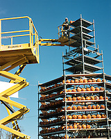 Placing Jack o Lanterns on  South Tower, Keene Pumpkin Festival