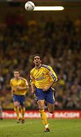 Photo. Richard Lane<br />Arsenal v Southampton. FA Cup Final. 17/05/2003.<br />Claus Lundekvam chases the ball back.