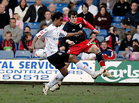 Photo: Leigh Quinnell.<br /> Luton Town v Southampton. Coca Cola Championship. 07/04/2007. Southamptons Gareth Bale gets the ball away from Lutons Richard Langley.