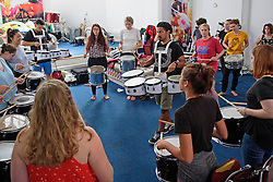 © Licensed to London News Pictures. 25/08/2016. London, UK. Members of the carnival group 'Youth With A Mission' practice playing drums ahead of the annual Notting Hill Carnival which starts this bank holiday weekend. Photo credit: Ben Cawthra/LNP