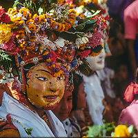 A masked dancer mingles with crowds at a Hindu festival in Kathmandu, Nepal.