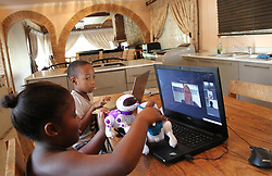 South Africa - Durban - 29 April 2020 - Ayamaah Mazibuko (7) grade 1 at Maris Stella and Nkanyezi Mazibuko (10) grade 4 at Durban Preparatory School (DPHS) noth from Westville doing online learning at home<br /> Picture: Doctor Ngcobo/African News Agency(ANA)