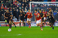 Daniel Pinillos of Barnsley (23) defends as Will Grigg of Sunderland (22) and Aidan McGeady of Sunderland (19) chase him during the EFL Sky Bet League 1 match between Barnsley and Sunderland at Oakwell, Barnsley, England on 12 March 2019.