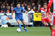 AFC Wimbledon defender Will Nightingale (5) dribbling during the EFL Sky Bet League 1 match between AFC Wimbledon and Doncaster Rovers at the Cherry Red Records Stadium, Kingston, England on 9 March 2019.