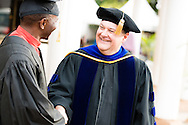 The Rev. Dr. Lawrence R. Rast, Jr., president of Concordia Theological Seminary, Fort Wayne, Ind., shakes hands  with Bishop Emmanuel Makala, following the graduation of 21 pastors and seven deaconesses on Saturday, March 14, 2015, at the Evangelical Lutheran Church in Tanzania – South-East of Lake Victoria Diocese's (ELCT-SELVD) Ebenezer Cathedral  in Shinyanga, Tanzania. LCMS Communications/Erik M. Lunsford