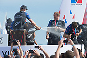 Americas's Cup Village, Bermuda 12th June 2017. Emirates Team New Zealand helmsman Peter Burling sprays sailors Josh Junior, Blair Tuke and Glenn Ashby with champagne on stage after winning the Louis Vuitton America's Cup Challenger series.