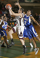 Kingston's Rachel Coffey, center, drives to the basket as North Babylon's Eugeneia McPherson, right, defends during a Class AA state semifinal game at Hudson Valley Community College in Troy on March 16, 2007.