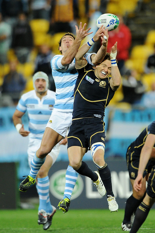 Santiago Fernandez (left) and Rory Lawson (right) jump for the ball during the Pool B, Argentina v Scotland match at the IRB Rugby World Cup 2011. Wellington Regional Stadium, Wellington. Sunday 25 September 2011...Photo: Mark Tantrum/photosport.co.nz..