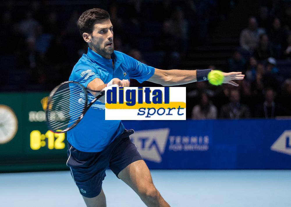 Tennis - 2019 Nitto ATP Finals at The O2 - Day One<br /> <br /> Singles Group Bjorn Borg: Novak Djokovic vs. Matteo Berrettini<br /> <br /> Novak Djokovic (Serbia) reaches across to make the passing shot<br /> <br /> COLORSPORT/DANIEL BEARHAM