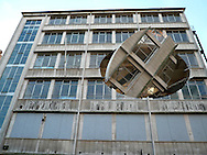 Richard Wilson's art installation entitled Turning the Place Over which is located in a former bar in Moorfields, Liverpool. The artist created the installation by removing a section from a derelict Yates Wine Lodge which was then rotated using a giant hydraulic arm inside the building. Liverpool was European Capital of Culture in 2008 and this installation was created for the event..