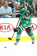 DALLAS, TX - OCTOBER 17:  Alex Goligoski #33 of the Dallas Stars takes a shot on goal against the San Jose Sharks on October 17, 2013 at the American Airlines Center in Dallas, Texas.  (Photo by Cooper Neill/Getty Images) *** Local Caption *** Alex Goligoski