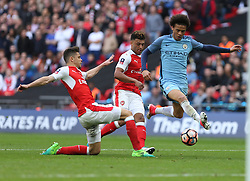 23 April 2017 FA Cup semi-final : Arsenal v Manchester City :<br /> Leroy Sane of City is tackled by Gabriel.<br /> Photo: Mark Leech