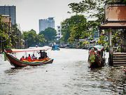 20 APRIL 2015 - BANGKOK, THAILAND:     Long tail boats haul passengers along Khlong Bangkok Yai in the Thonburi section of Bangkok. Khlong is the Thai word of canal. Khlong Bangkok Yai is one of the busiest canals in Bangkok. PHOTO BY JACK KURTZ