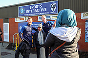 AFC Wimbledon midfielder Mitchell (Mitch) Pinnock (11) and AFC Wimbledon attacker Shane McLoughlin (19) posing for a photo  with a fan during the EFL Sky Bet League 1 match between AFC Wimbledon and Peterborough United at the Cherry Red Records Stadium, Kingston, England on 18 January 2020.