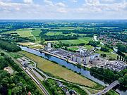 Nederland, Gelderland, Gemeente Lochem, 21–06-2020; Twentekanaal in Lochem, zicht op bedrijventerrein Goorseweg met onder andere FrieslandCampina. Station van Lochem in de voorgrond. (spoorlijn Zutphen - Glanerbeek.<br /> Twente canal in Lochem, a view of the Goorseweg industrial estate including FrieslandCampina<br /> <br /> luchtfoto (toeslag op standaard tarieven);<br /> aerial photo (additional fee required)<br /> copyright © 2020 foto/photo Siebe Swar