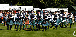 Inveraray Highland Games. Inveraray and District Pipe Band lead the parade from the town centre to the games field at Inveraray Castle. The Duke of Argyll and other dignitaries follow the pipe band to the games field where His Grace officially open the games...... (c) Stephen Lawson | Edinburgh Elite media