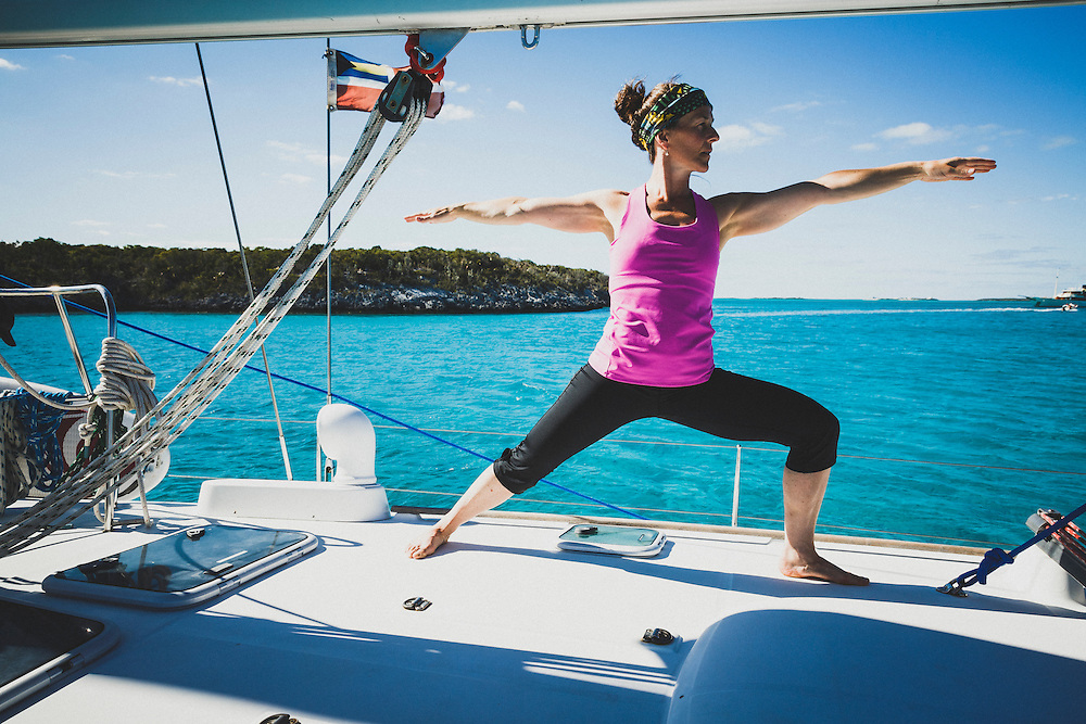 Jacki Arevalo practices yoga onboard the Grand Illusion II sailboat during a weeklong bareboating excursion in the Exumas Cays, Bahamas.
