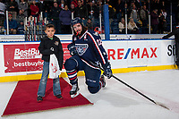 KELOWNA, CANADA - JANUARY 3: Nolan Yaremko #22 of the Tri-City Americans kneels down with a young fan to accept the second star of the game against the Kelowna Rockets on January 3, 2017 at Prospera Place in Kelowna, British Columbia, Canada.  (Photo by Marissa Baecker/Shoot the Breeze)  *** Local Caption ***