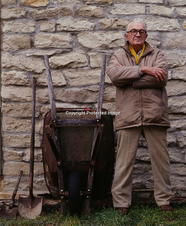 The late legendary Texas author, John Graves, outside his ranch home on Hard Scrabble. Graves cut and set every stone in the ranch house by hand.