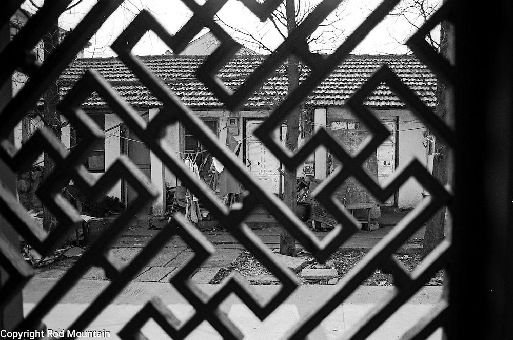 Exterior living quarters as seen through barred windows in China.