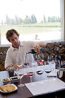 Santiago Santamaria pours glasses of wine in the new tasting room at Bodega Melipal in the Luján de Cuyo area of Mendoza, Argentina.
