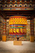 Large Buddhist prayer wheel with the mantra, Om Mani Padme Hum inscribed on it