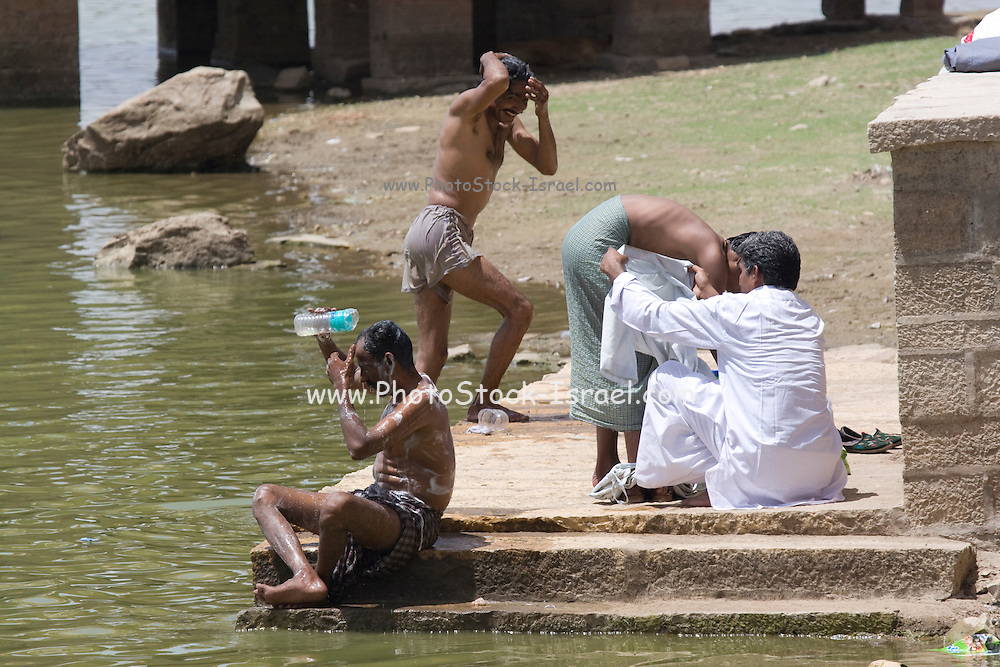 India, Rajasthan, Jaisalmer, people washing in the Gadi Sagar lake