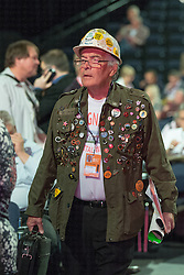 © Licensed to London News Pictures . 24/09/2014 . Manchester , UK . A man wearing a hard had and jacket with numerous stickers and badges in support of the National Union of Miners and others at the conference . The Labour Party Conference 2014 . Photo credit : Joel Goodman/LNP