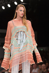 © Licensed to London News Pictures. 04/06/2013. London, England. Collection by graduate student Grace Cook from the De Montfort University Leicester. Graduate Fashion Week 2013 showcasing student collections takes place at Earl's Court II from 2 to 5 June 2013. Photo credit: Bettina Strenske/LNP