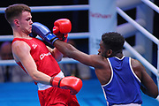 Lewis Richardson of Great Britain  (red)  and Victor Yoka of France (bue) competing in the Men's Middleweight preliminaries during The Road to Tokyo European Olympic Boxing Qualification, Sunday, March 15, 2020, in London, United Kingdom. (Mitchell Gunn-ESPA-Images/Image of Sport)