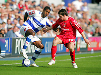 Photo: © Andrew Fosker / Richard Lane Photography -  QPR's Mikele Leigertwood (L) holds off a Jacob Butterfield challenge - Queens Park Rangers v Barnsley - Coca-Cola Championship - 26/09/09 Loftus Road - London -  UK - All Rights Reserved
