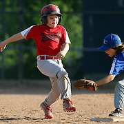 A runner is tagged out at second base during the Norwalk Little League baseball competition at Broad River Fields, Norwalk, Connecticut. USA. Photo Tim Clayton